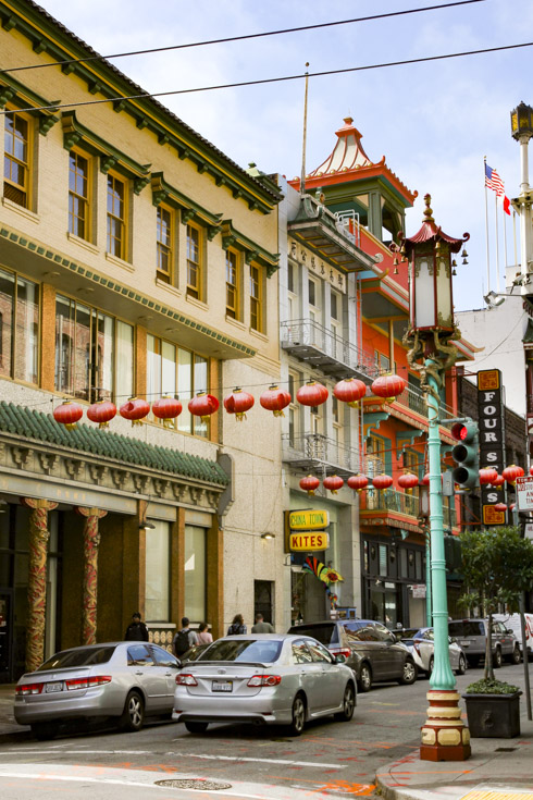 Chinatown street with red lanterns and pagoda inspired architecture