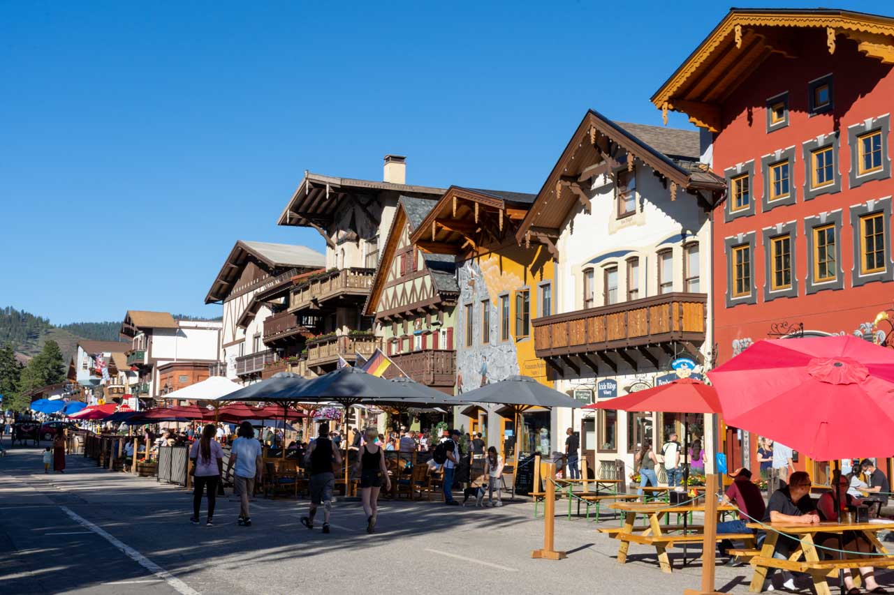 Bavarian streetscape with dining tables and umbrellas in the street