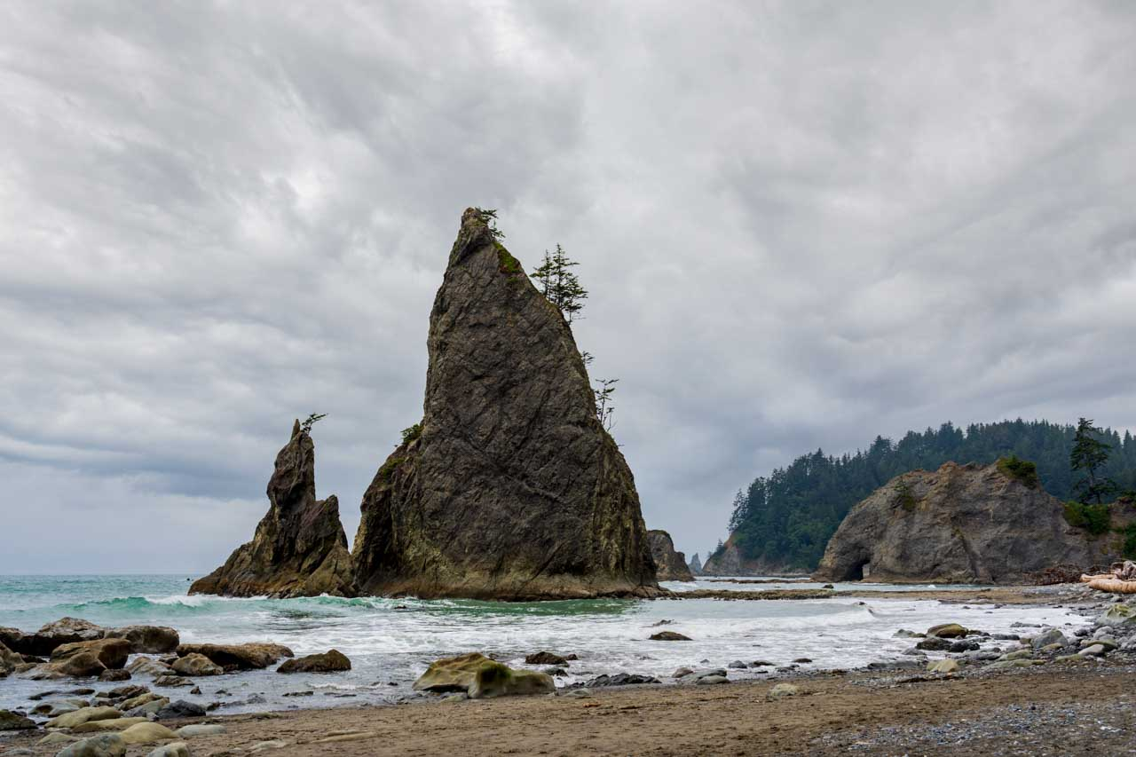 Sea stacks at a rocky beach with stormy sky